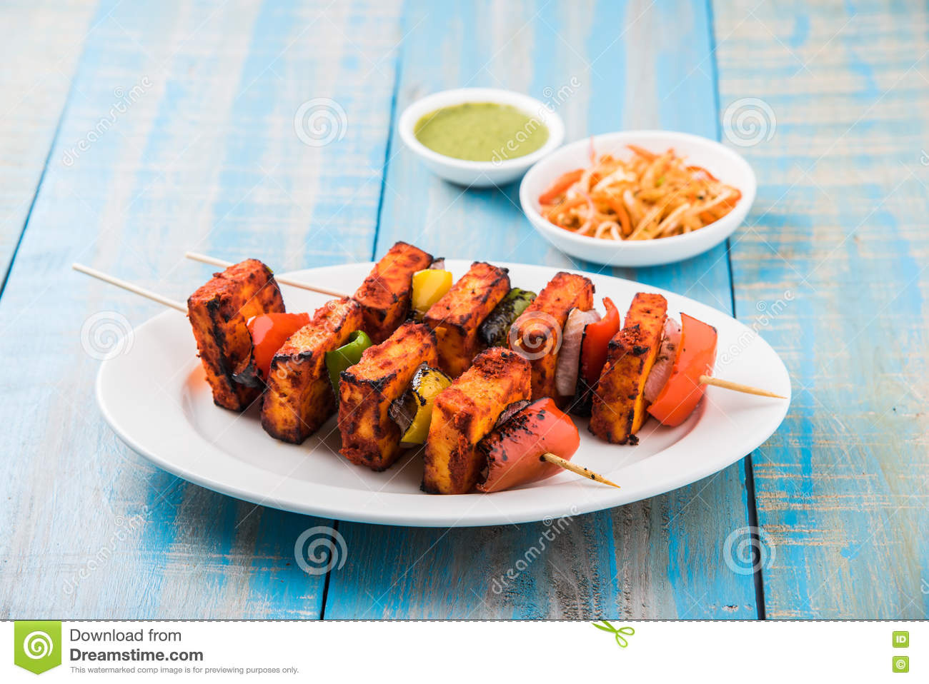 Grilled cottage cheese or also known as Paneer Tikka Kebab or chili paneer or chilli paneer or tandoori paneer in india India, bar