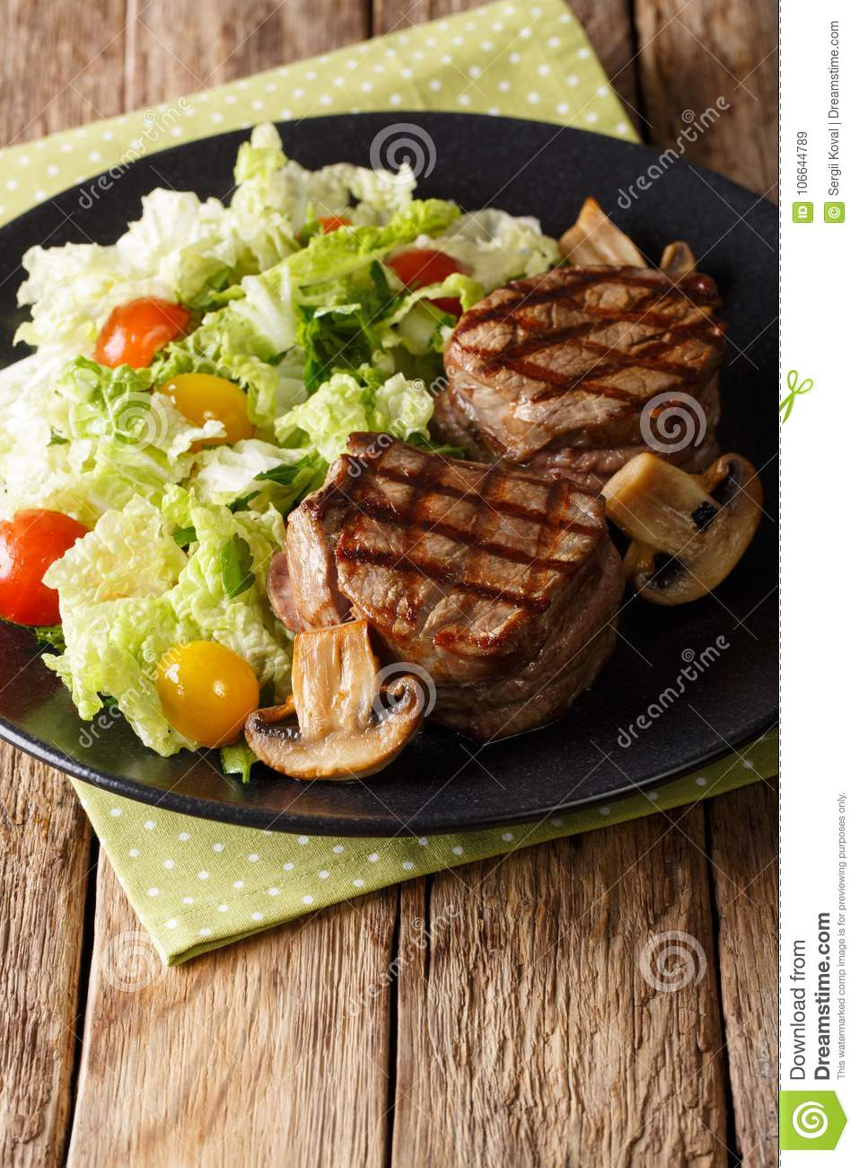 Grilled filet mignon steak with vegetable salad and mushrooms cl