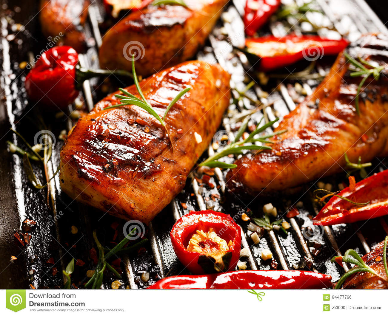 Grilled fillets of chicken in spicy marinade with the addition of chili on a grill pan