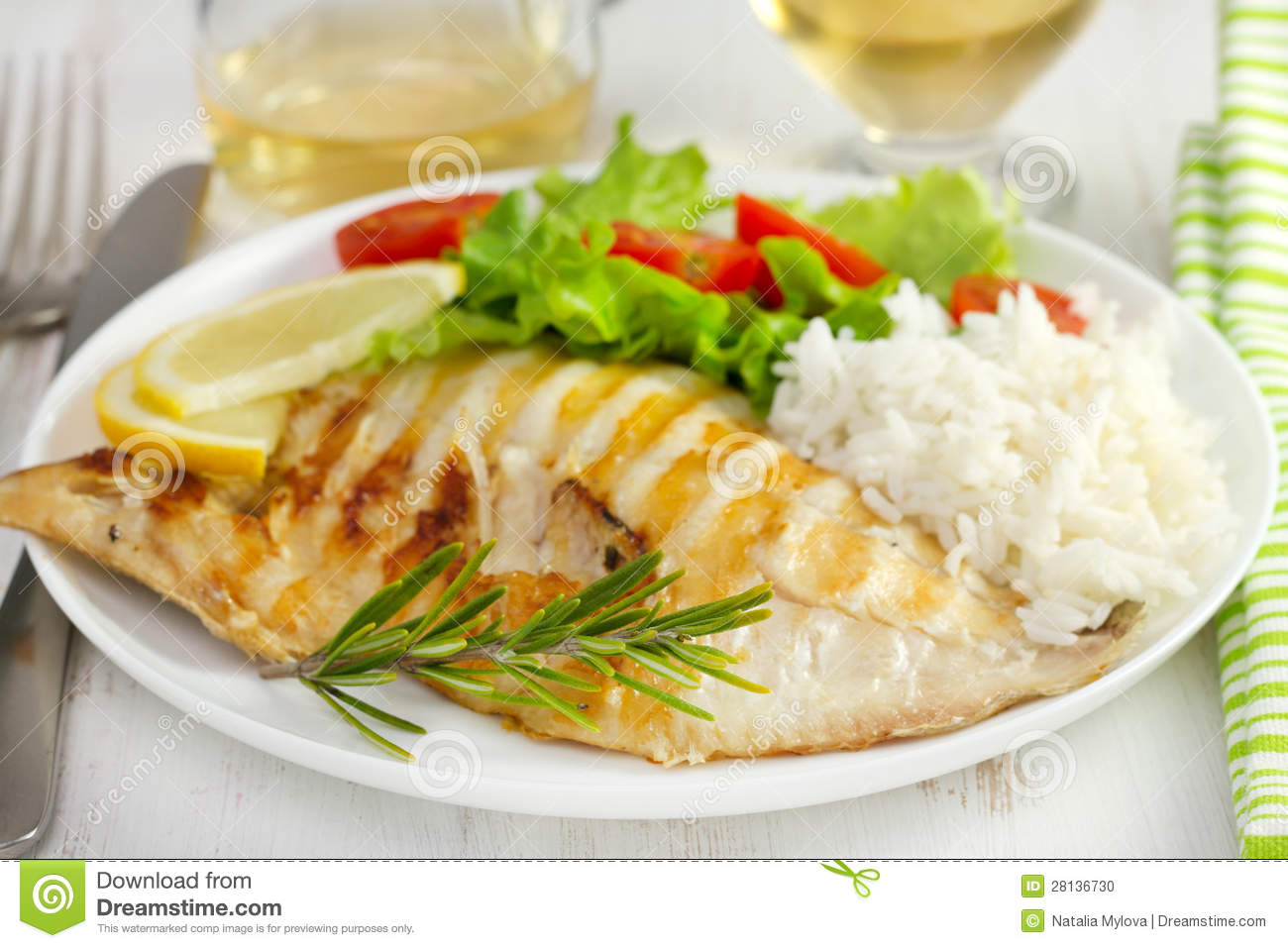 Grilled fish with boiled rice and salad stock photo for Fish and salad