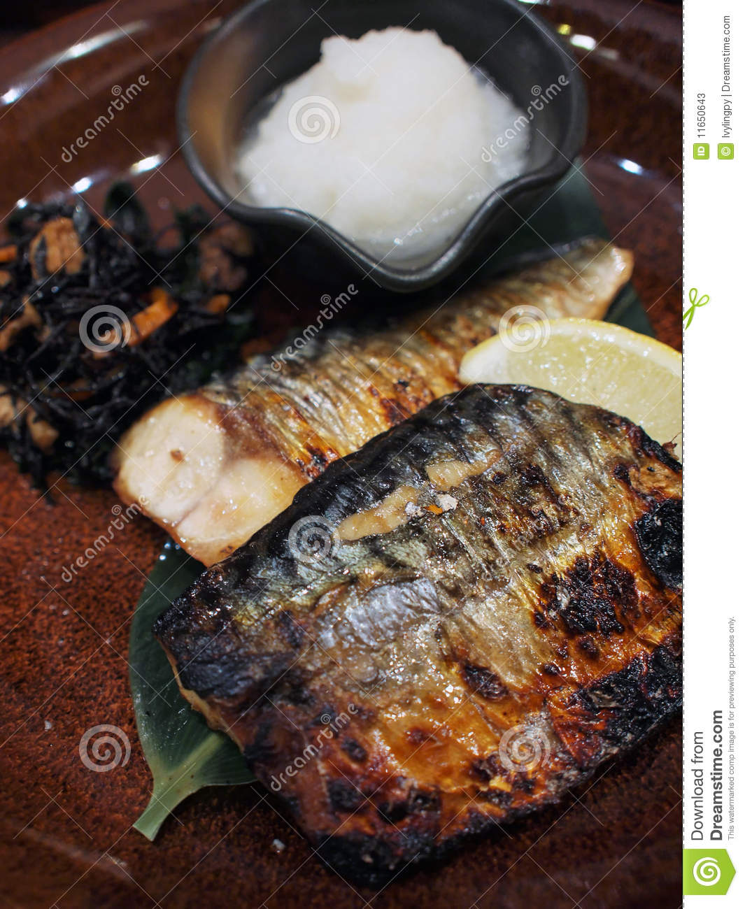 Japanese style grilled fish fillet (mackerel) served with lemon and ...