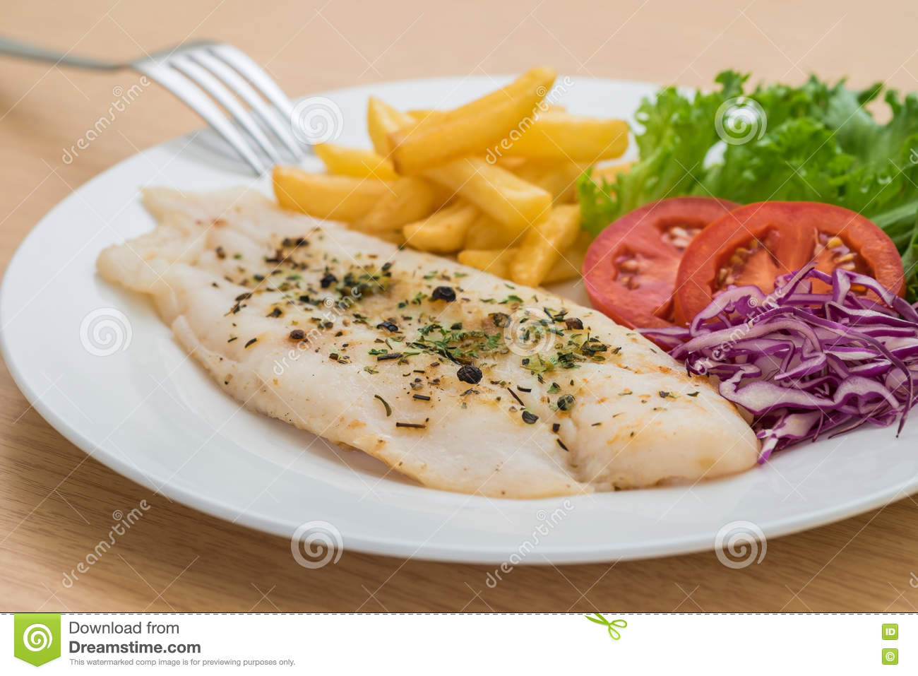 Grilled fish fillet steak with herb and french fries on for How to grill fish fillet