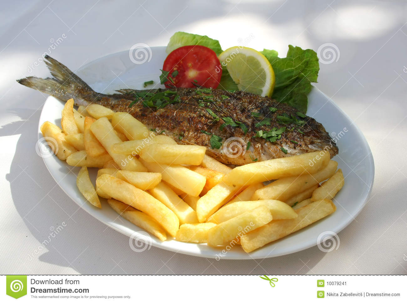 Grilled fish on the plate