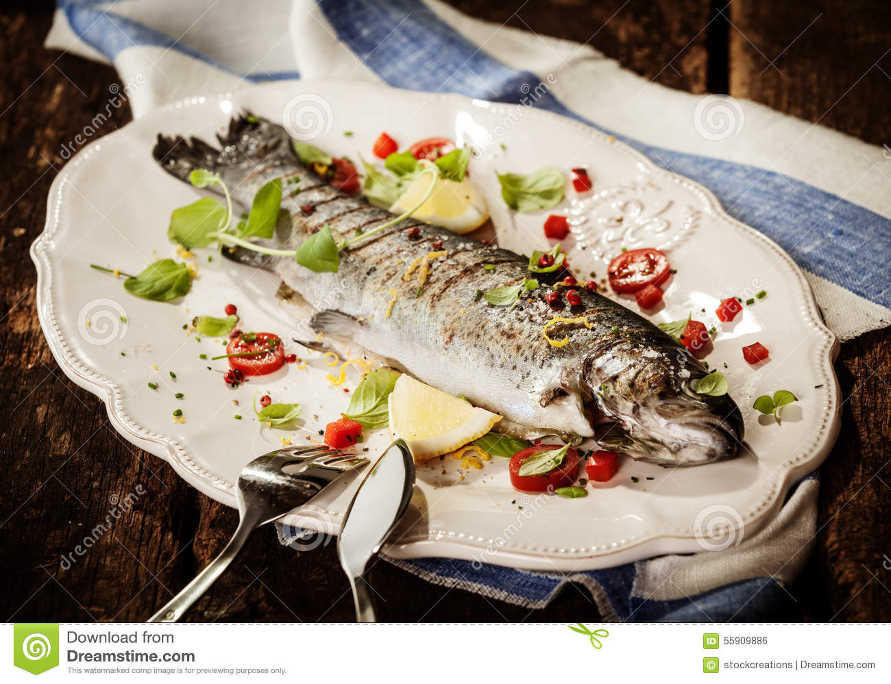 Grilled fish on platter with garnish and seasoning stock for Grilled fish seasoning