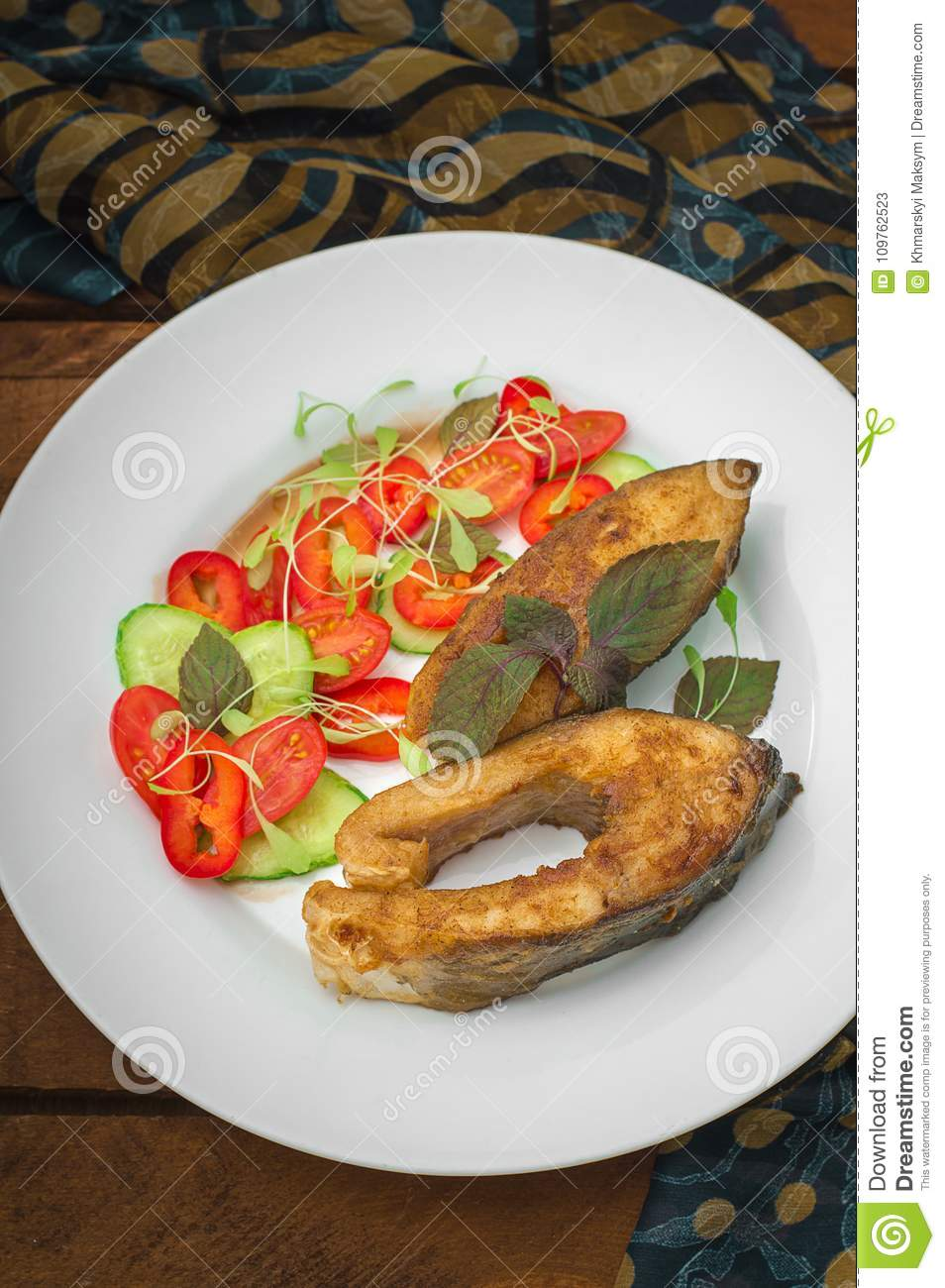 Grilled Fish Steak With Vegetables On Plate Tomatoes Microgran Cucumber Tasty And Healthy Dinner Wooden Rustic Background Top View