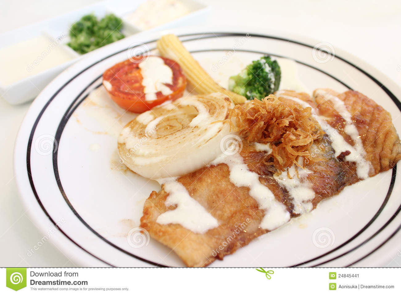 Grilled fish and vegetable with seasoning source stock for Grilled fish seasoning