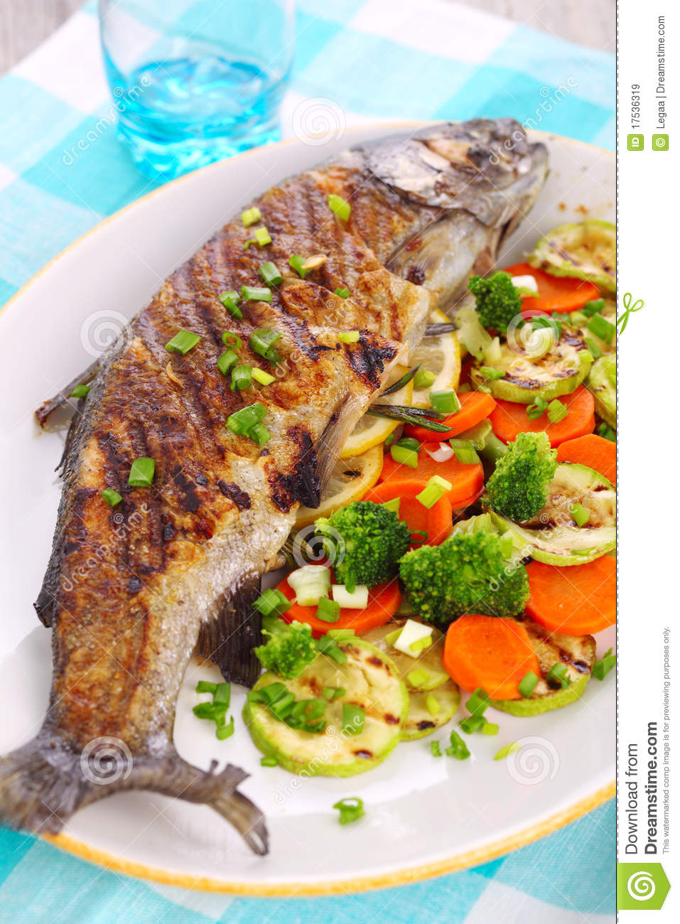 grilled fish with vegetables royalty free stock images
