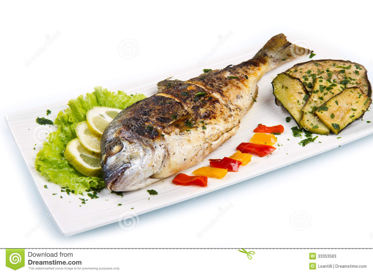 Grilled Gilt Head Sea Bream On Plate With Lemon ,salad And Grill Stock ...