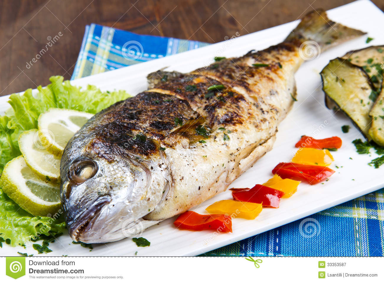... : Grilled gilt head sea bream on plate with lemon ,salad and grill