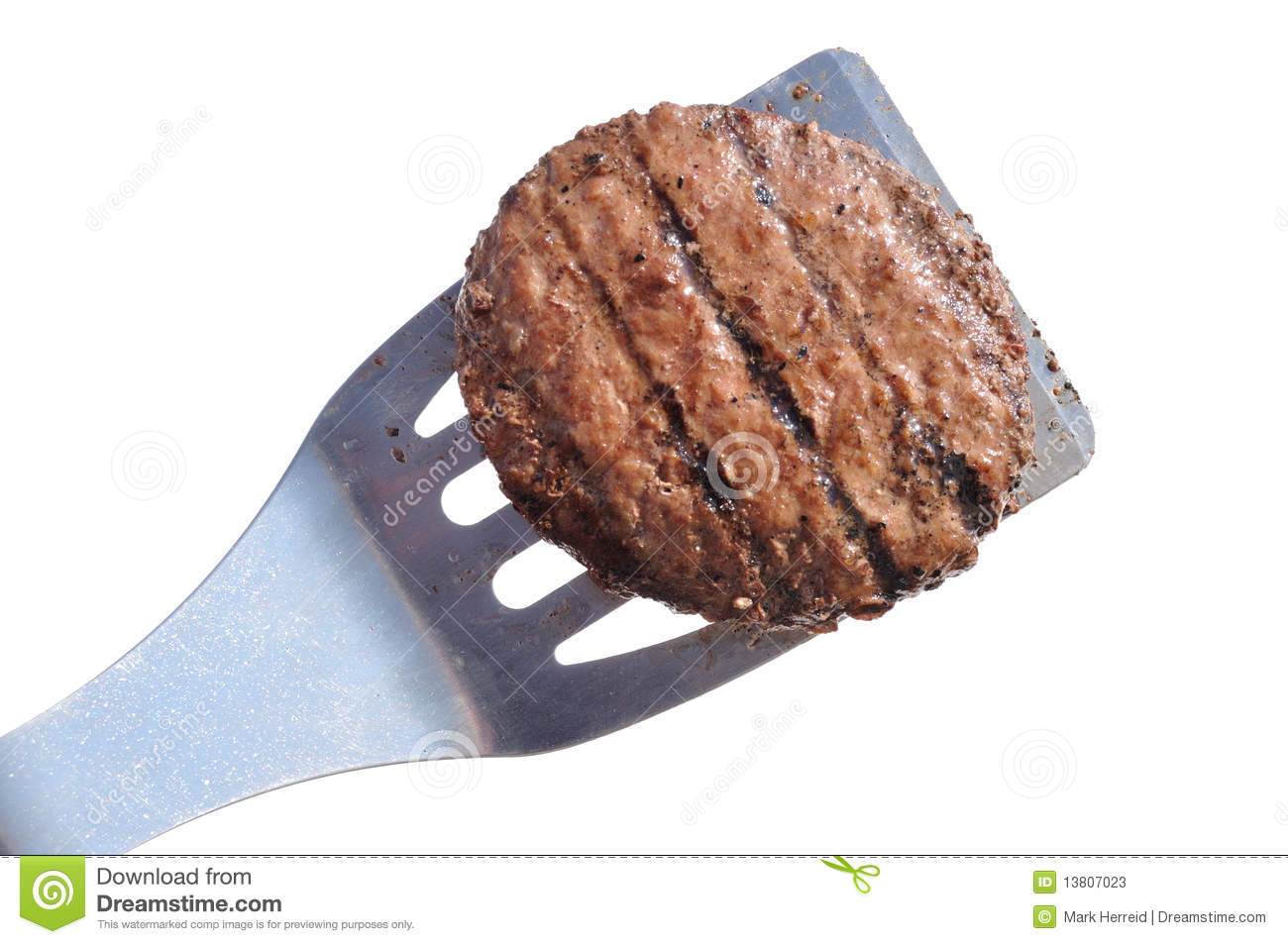 Grilled Hamburger Patty on a Spatula Isolated on White Grilled Hamburger Patty