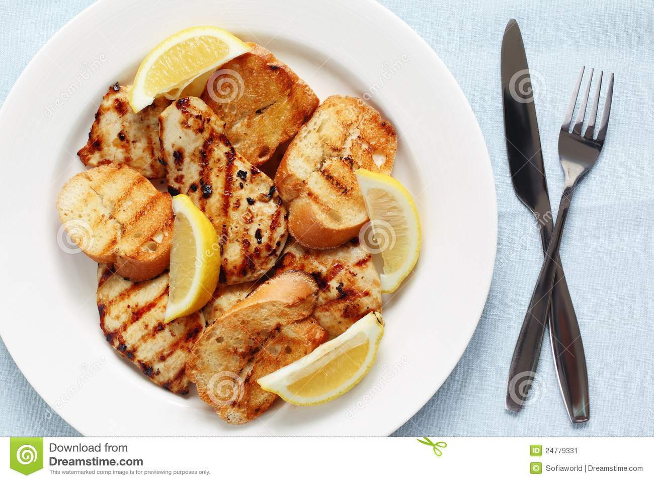 Grilled Lemon Chicken With Garlic Bread Stock Image - Image: 24779331