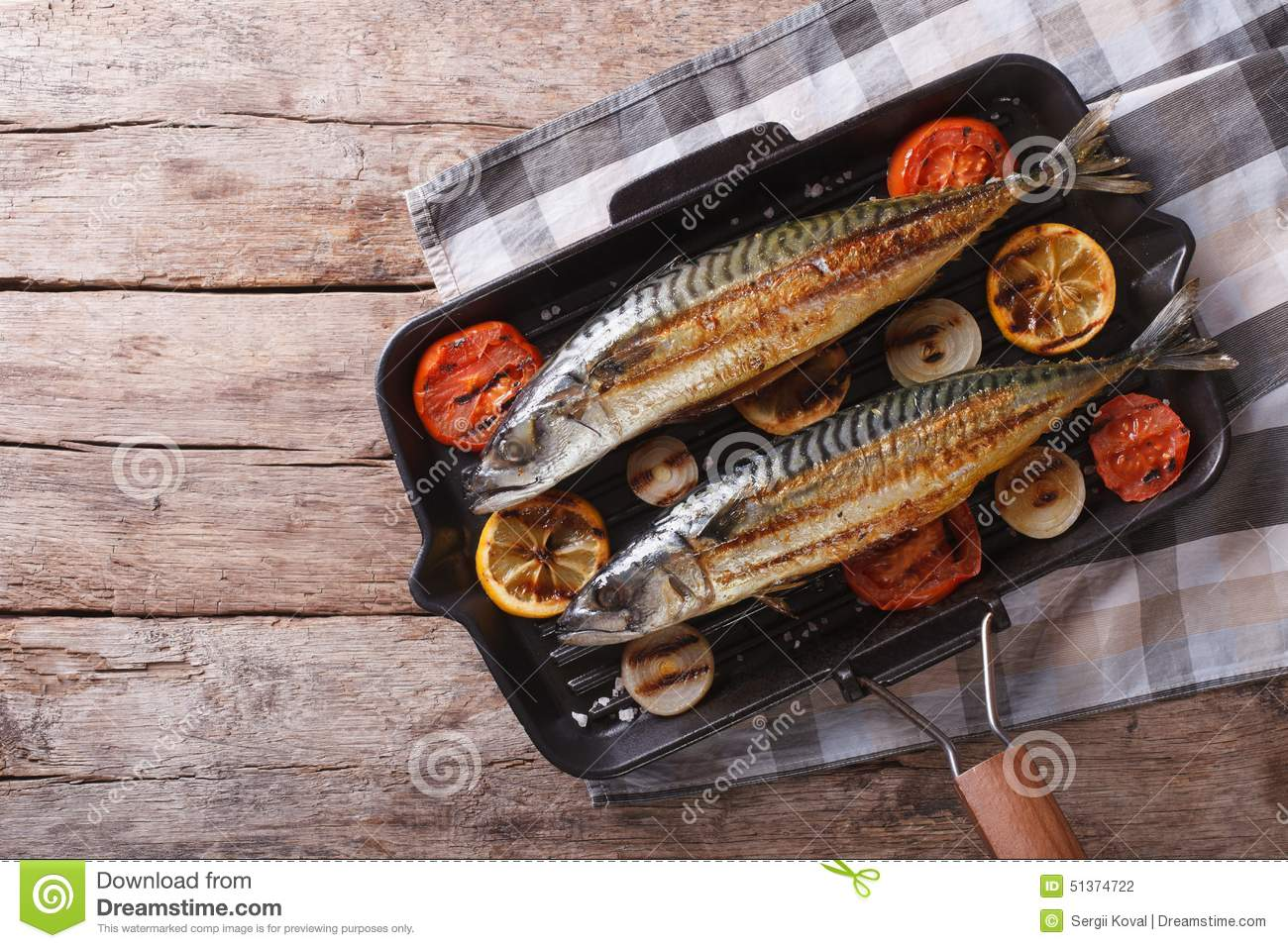 Grilled mackerel in pan with vegetables horizontal top for Pan grilled fish