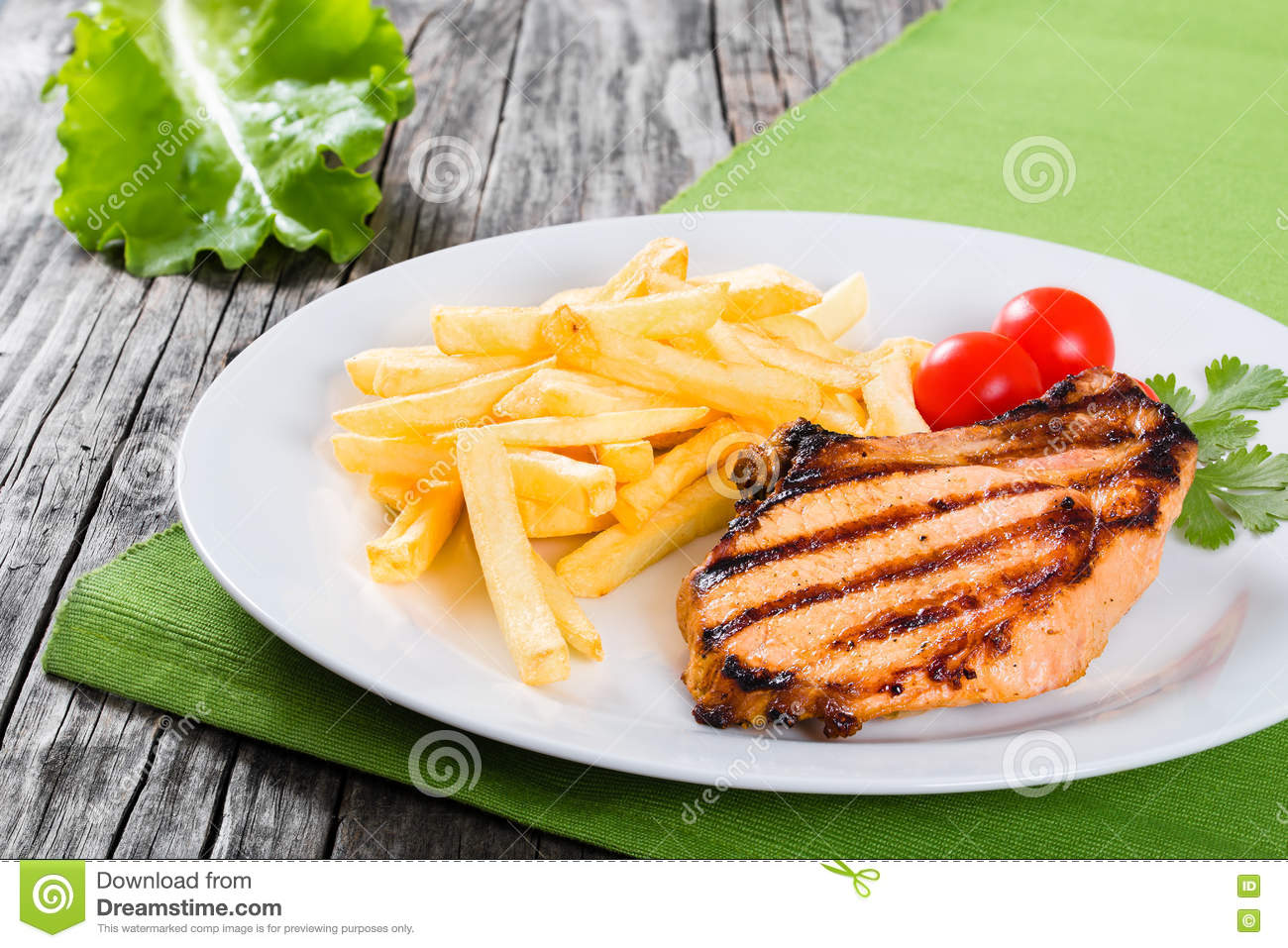 Grilled Pork Chops On A White Dish With French Fries Stock Image ...