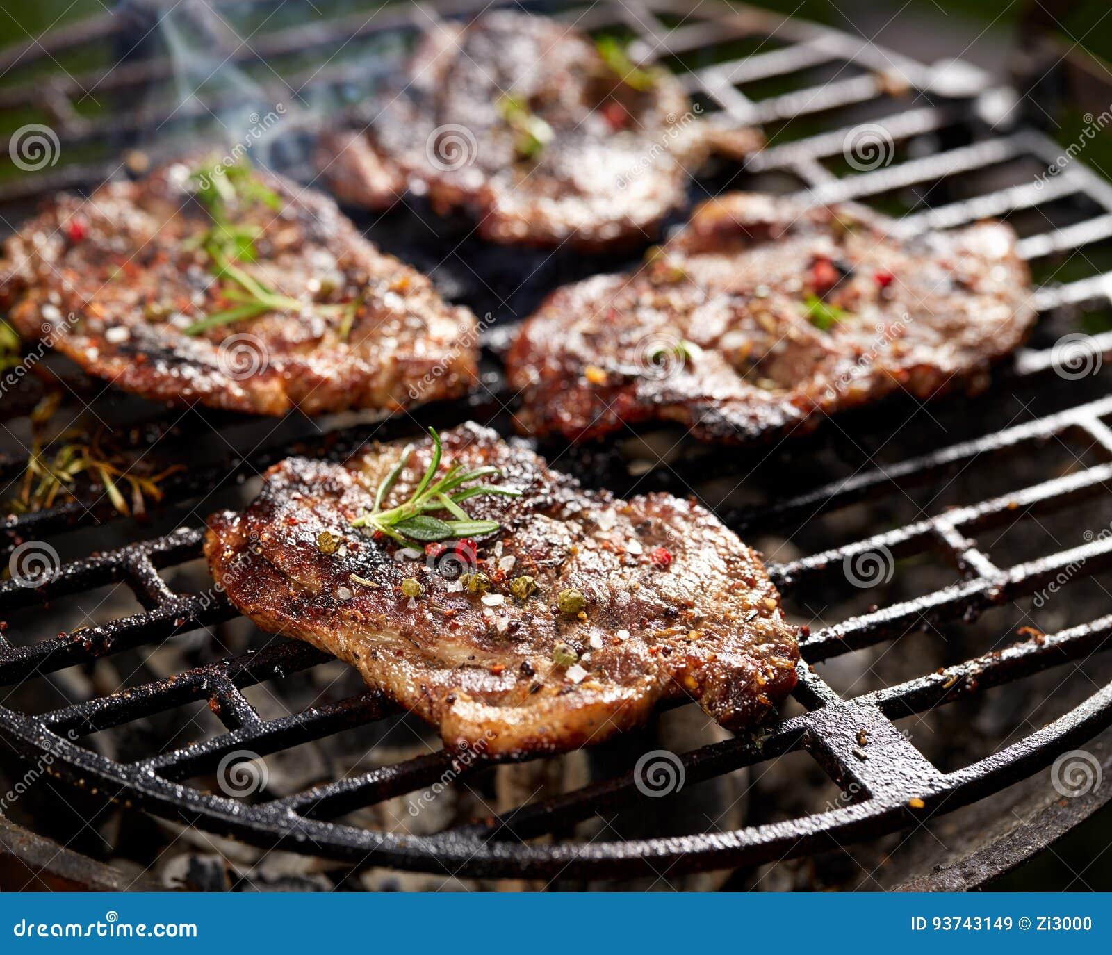 Grilled Pork Neck Steak. Roast Pork While Grilling Stock ...