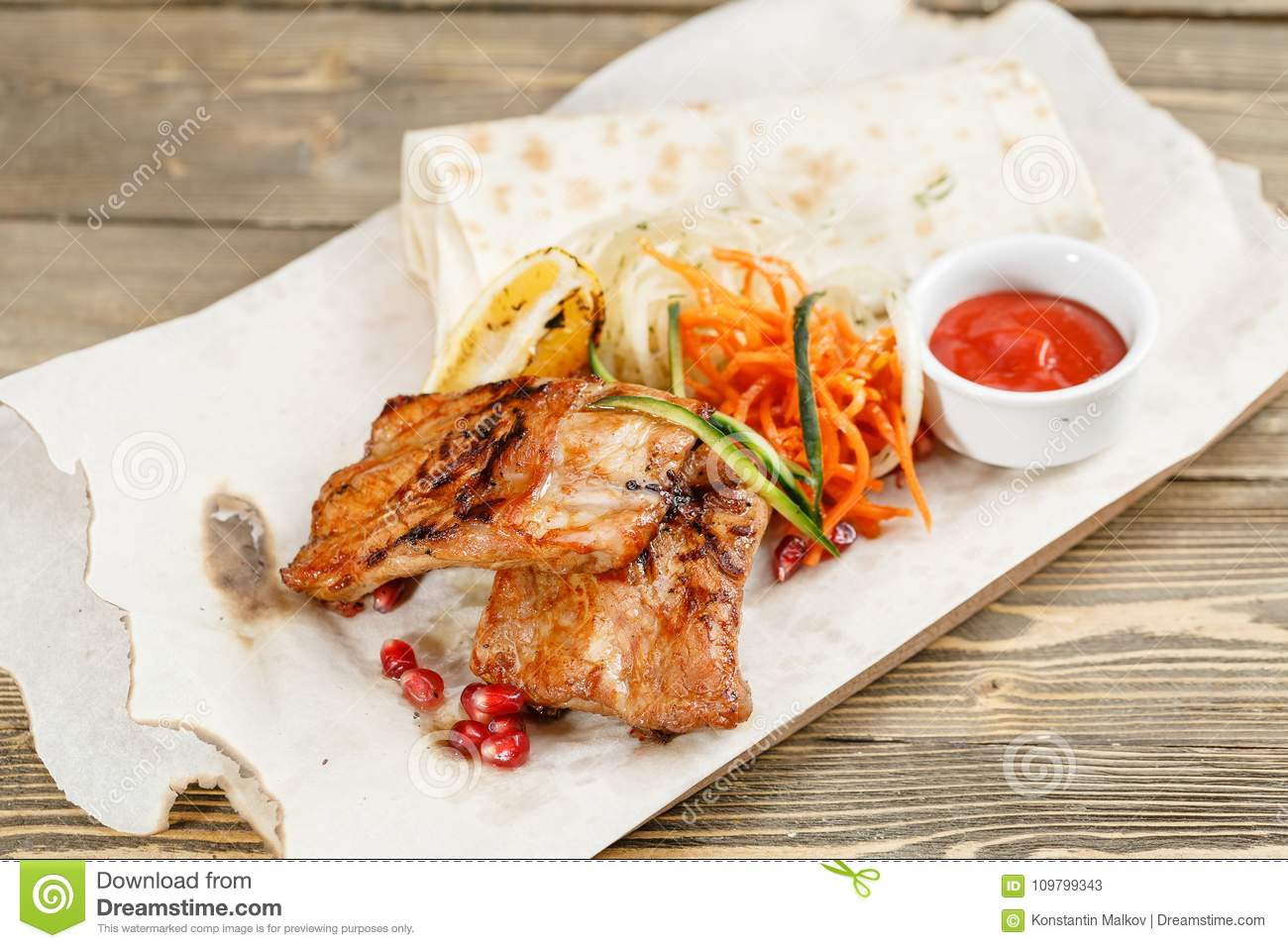Grilled Pork Ribs Serving On A Wooden Board On A Rustic Table