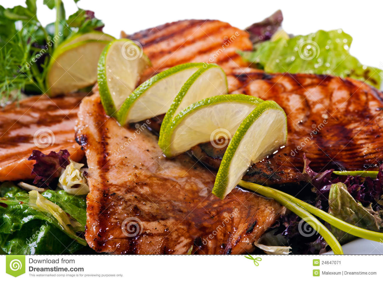 Grilled salmon fish steak with lime. Close-up on white background.