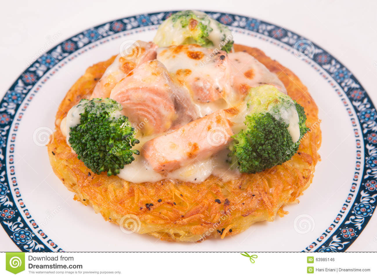 Grilled Salmon rosti with vegetables and bechamel and hollandaise on ...