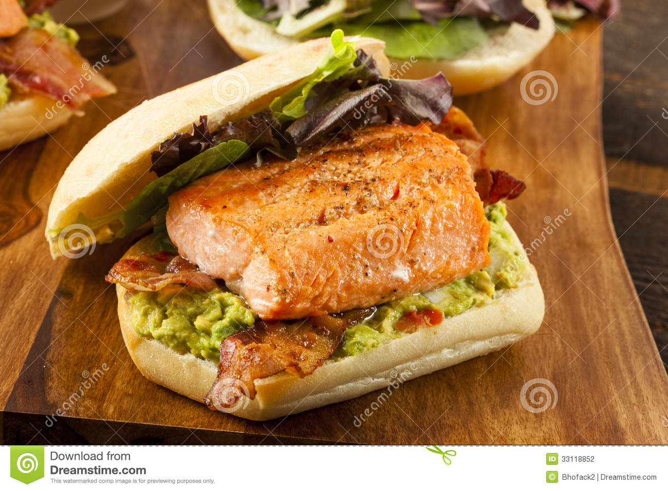 Grilled Salmon Sandwich With Bacon And Guacamole Stock ...