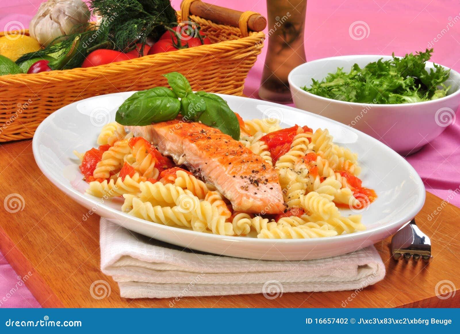 Grilled Salmon On Some Tomato Pasta Stock Photography ...