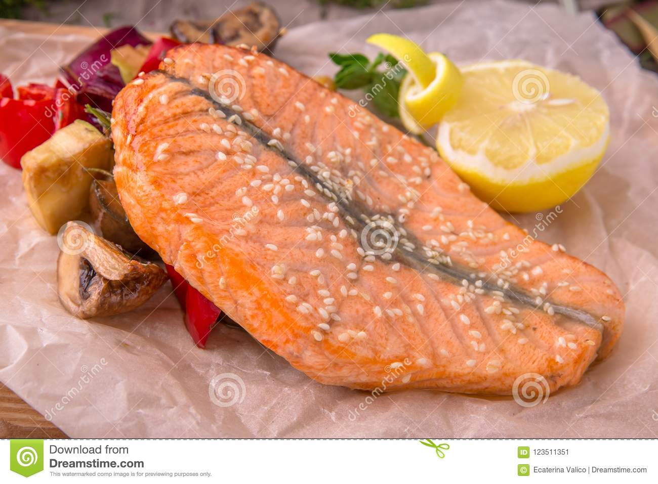 Grilled Salmon Steak With Vegetables On Wooden Table Beautiful