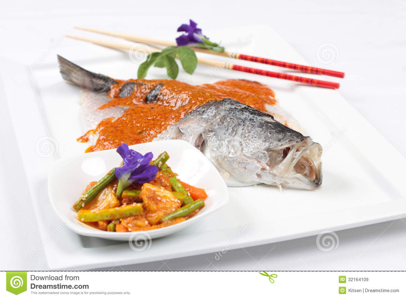 Grilled sea bass fish with red sauce and pickled for Side dish for fish