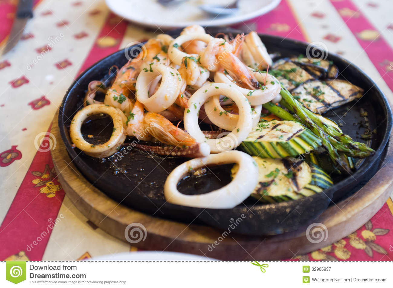 Grilled Seafood On Black Hot Plate