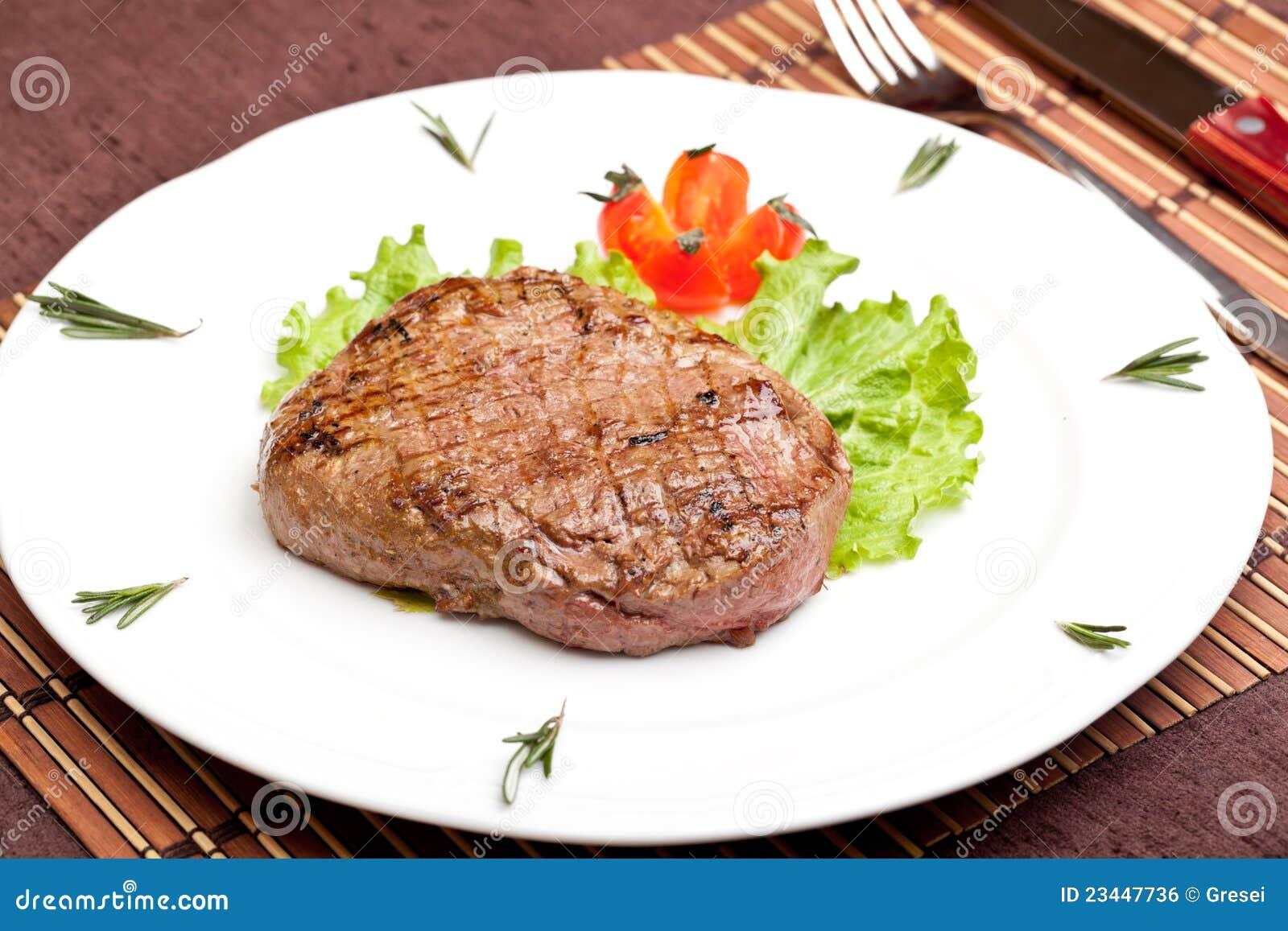 Grilled steak on a whi...