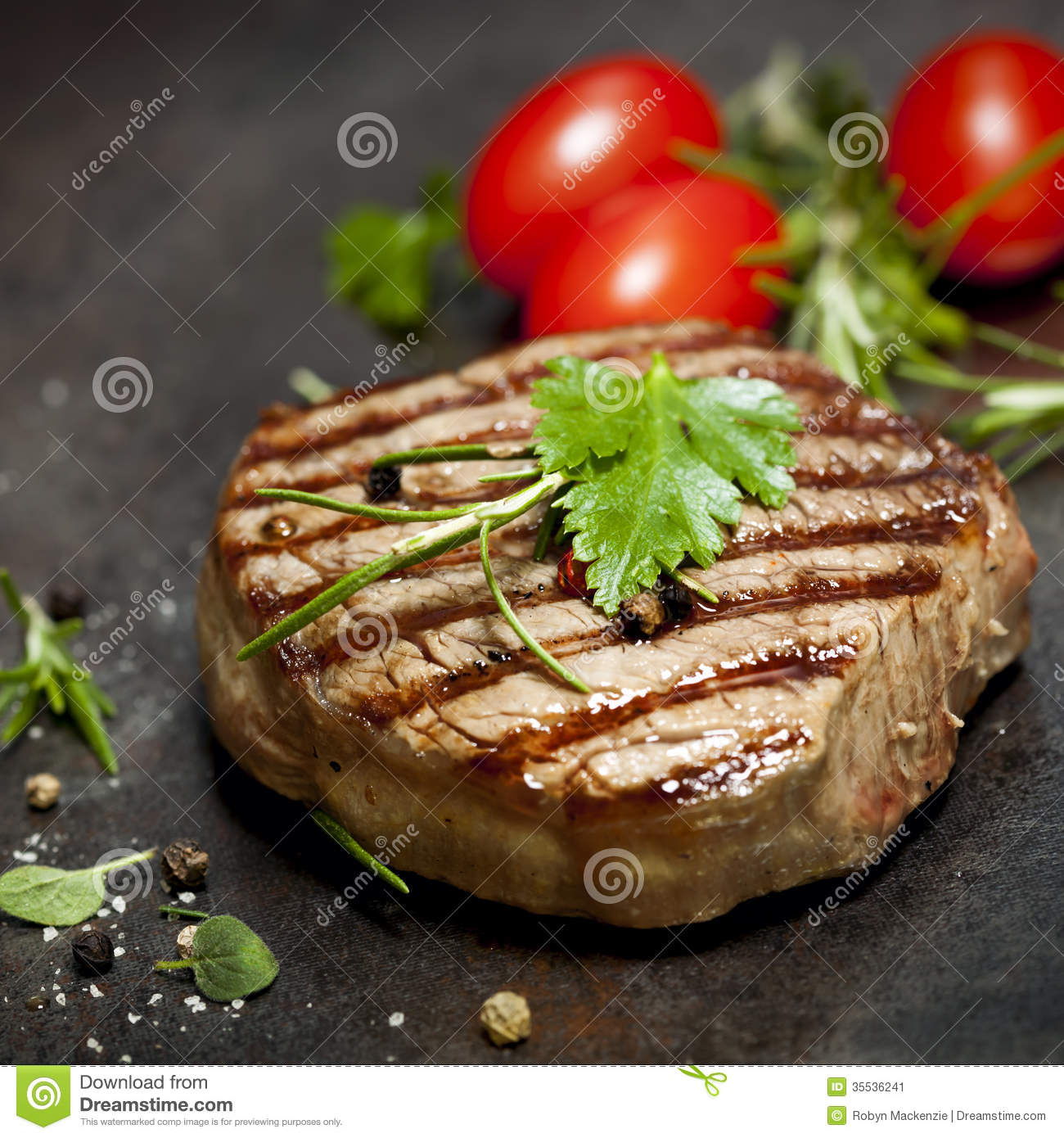 Grilled Steak With Herbs And Tomatoes Stock Image - Image: 35536241