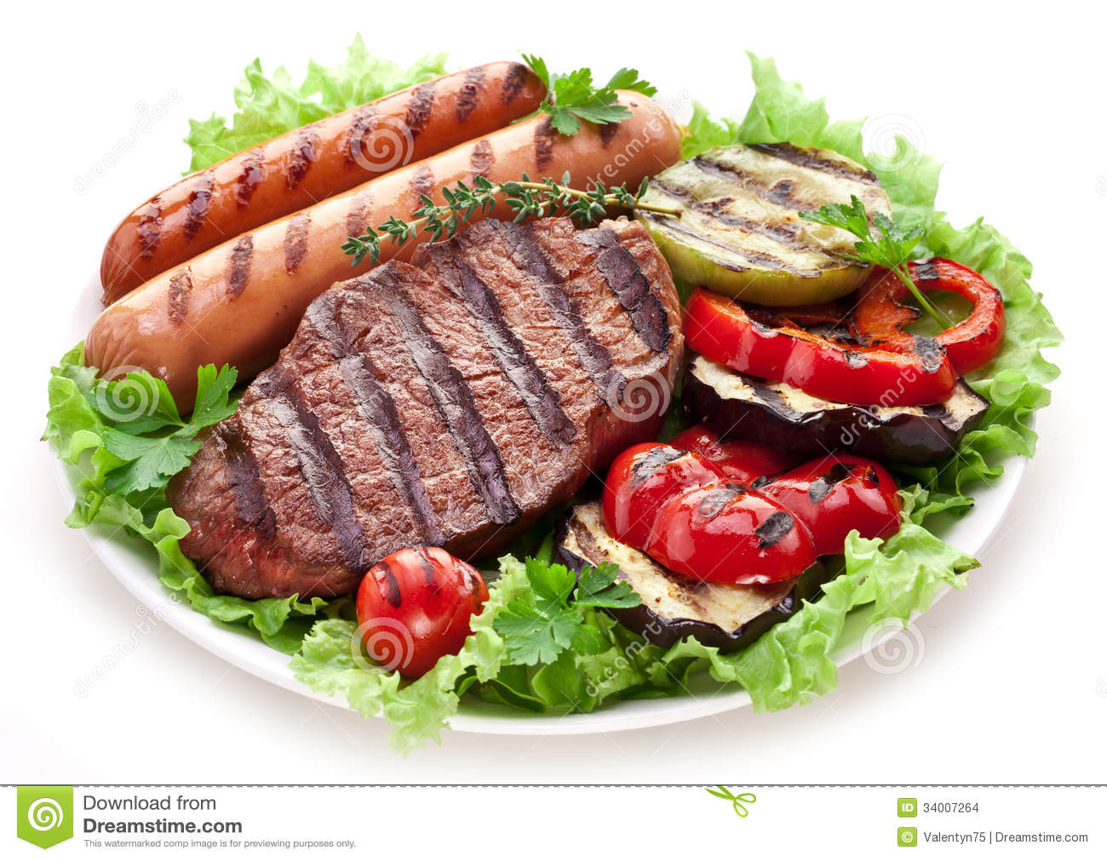Grilled steak,sausages and vegetables.