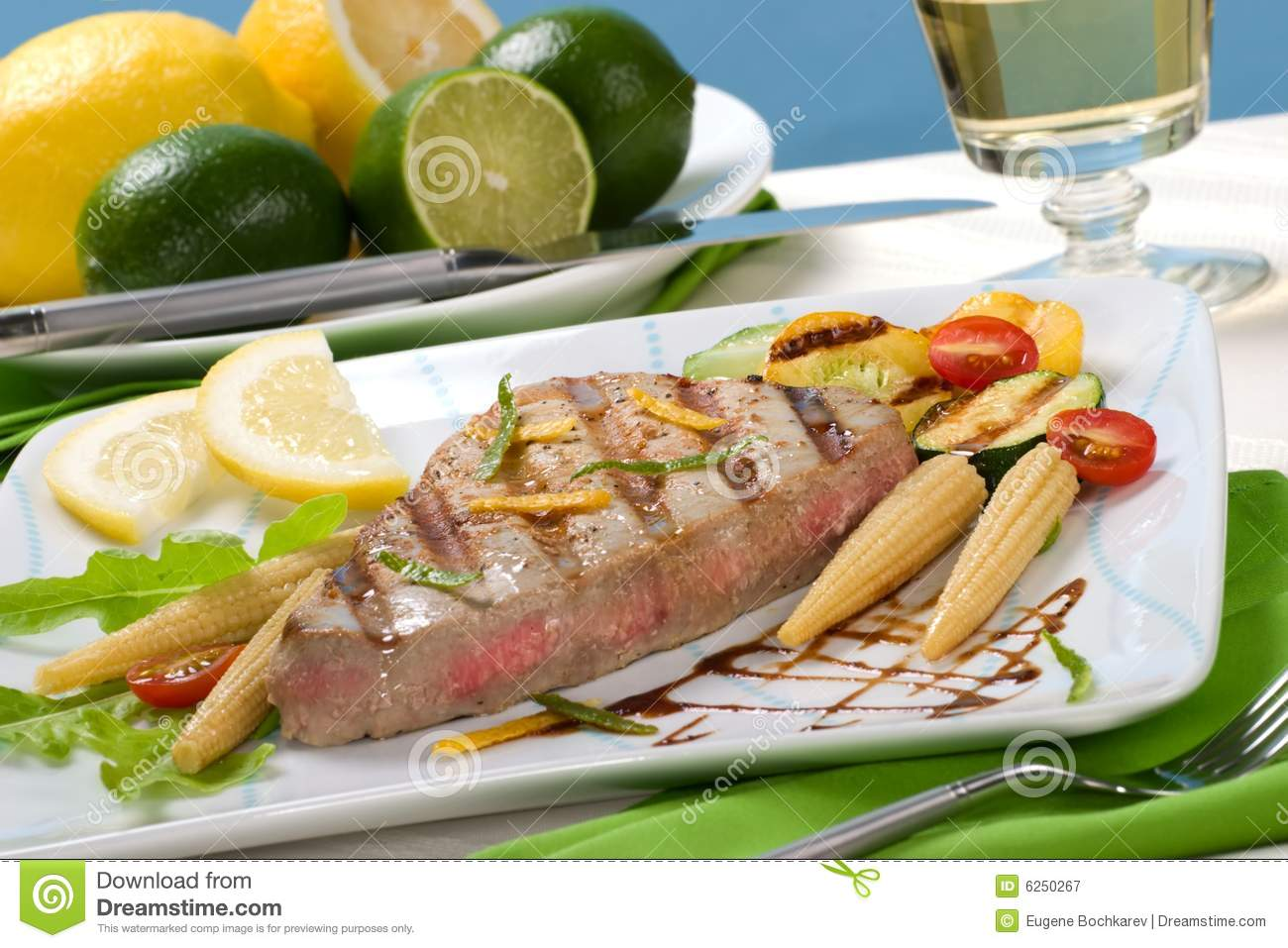 ... Citrus-peppercorn-spiked grilled tuna steak with grilled vegetables