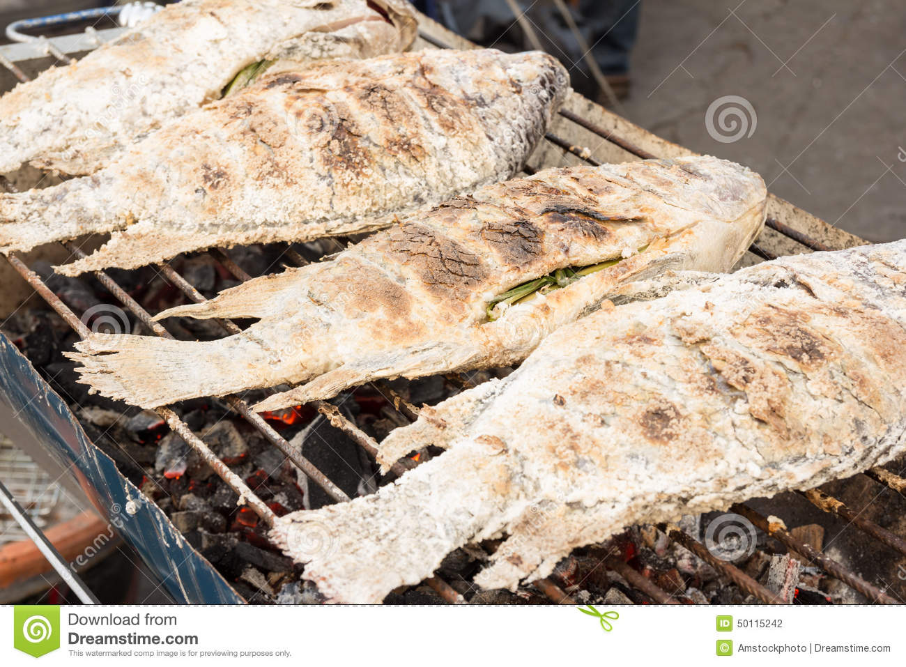 Grilled white snapper fish coated rock salt stock photo for Oak city fish and chips menu