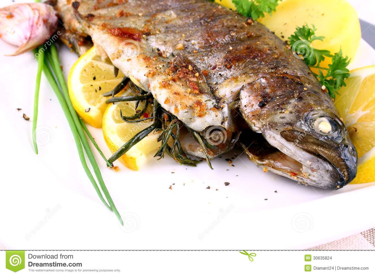 Grilled Whole Trout With Potato, Lemon And Garlic Stock Images - Image ...