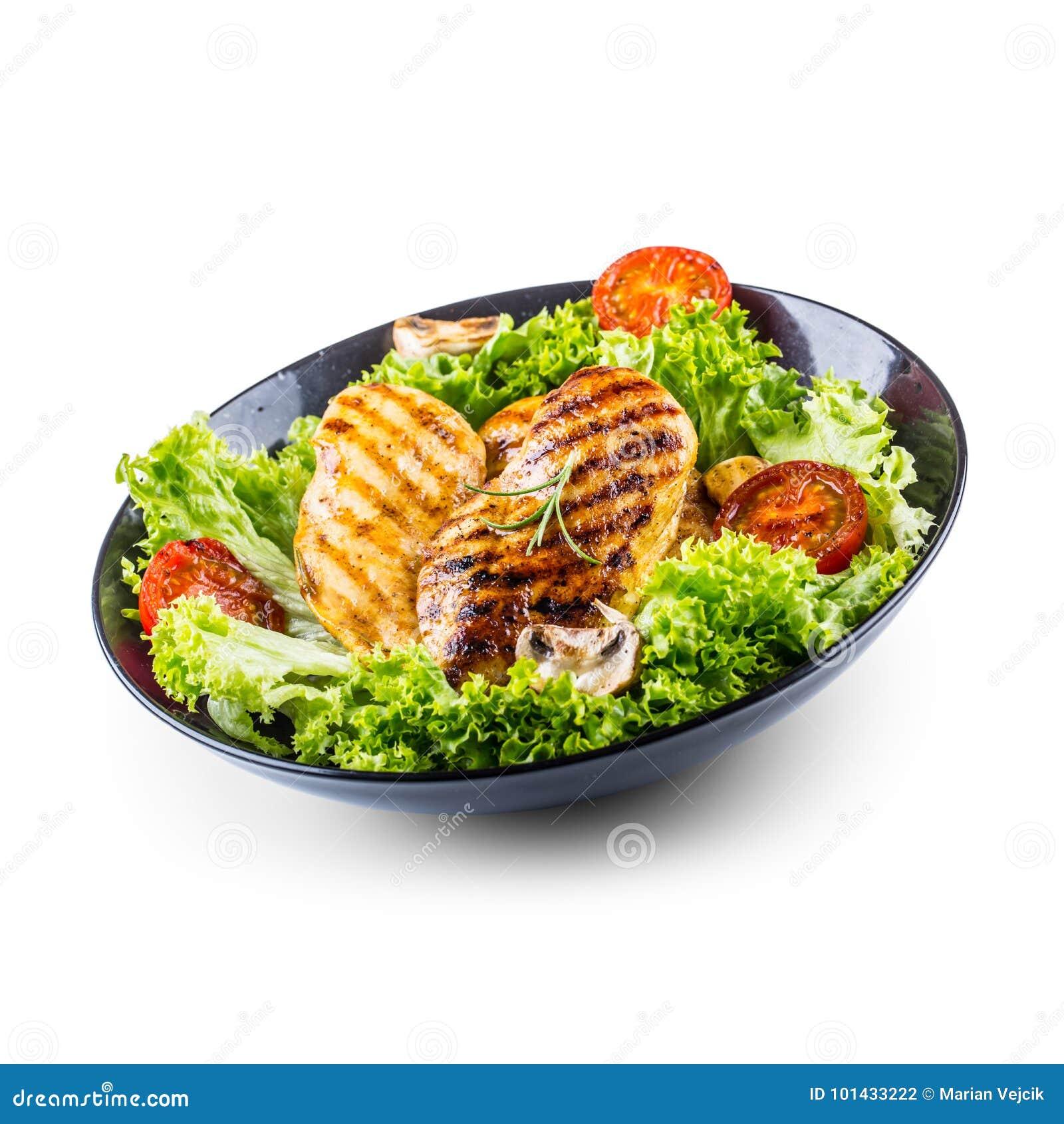 Grillez le blanc de poulet rôti et grillez le blanc de poulet avec des tomates et des champignons de salade de laitue d isolement