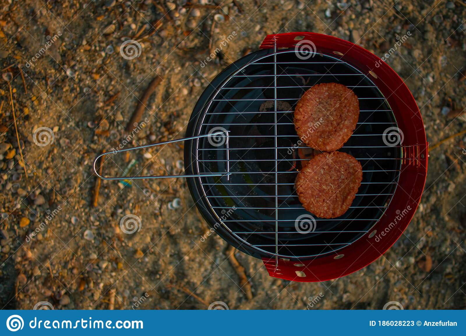 Grilling Burgers On A Small Metal Portable Charcoal Grill On The Shores Of Lac Leman In Switzerland During Early Winter Evening Stock Image Image Of Beautiful Grilling 186028223