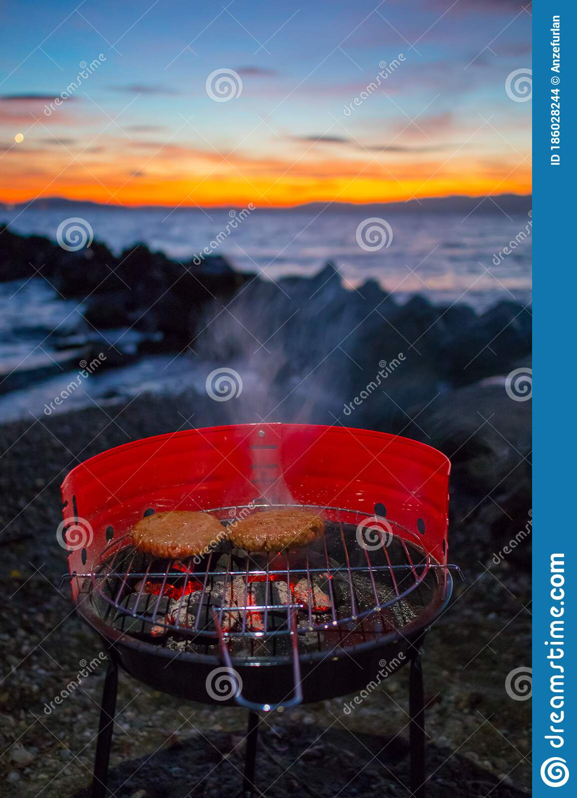 Grilling Burgers On A Small Metal Portable Charcoal Grill On The Shores Of Lac Leman In Switzerland During Early Winter Evening Stock Photo Image Of Orange Charcoal 186028244