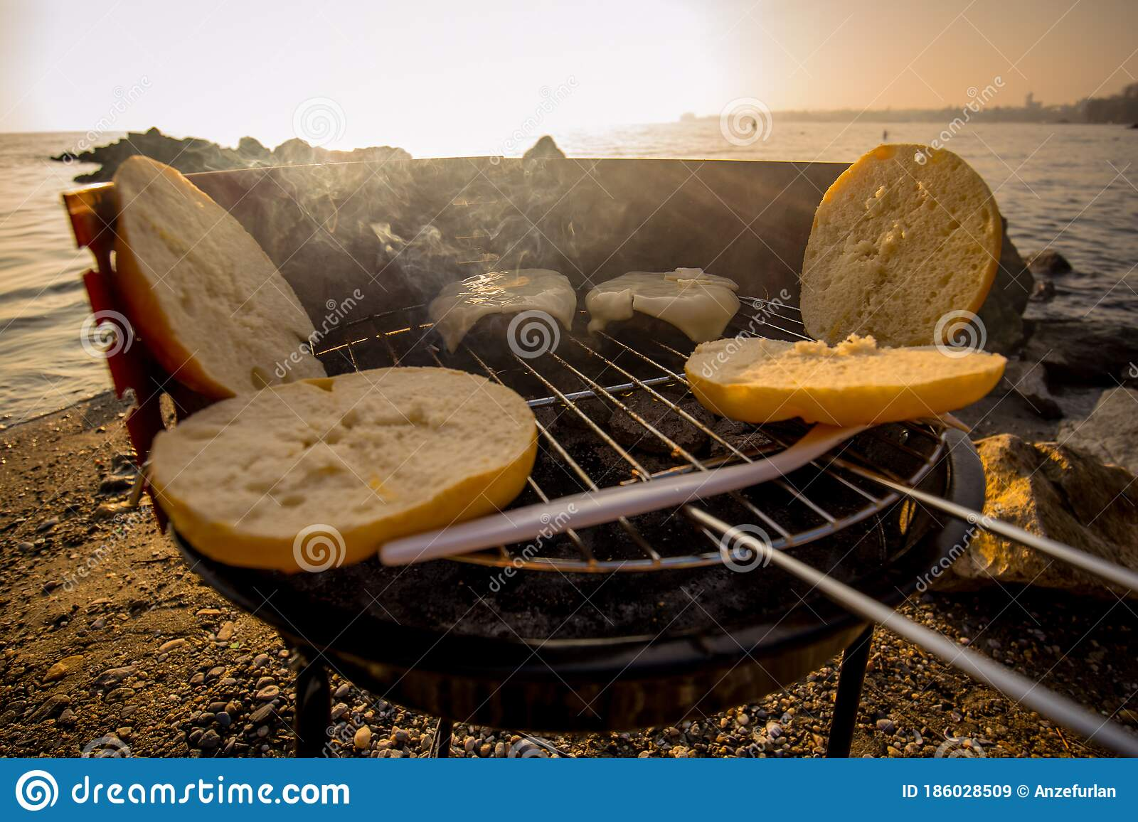 Grilling Burgers On A Small Metal Portable Charcoal Grill On The Shores Of Lac Leman In Switzerland During Early Winter Evening Stock Image Image Of Nature Grilling 186028509