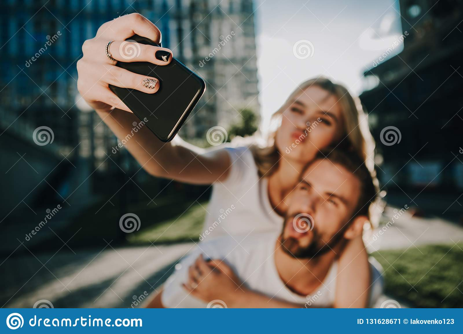 Grimacing couple of young people making photo