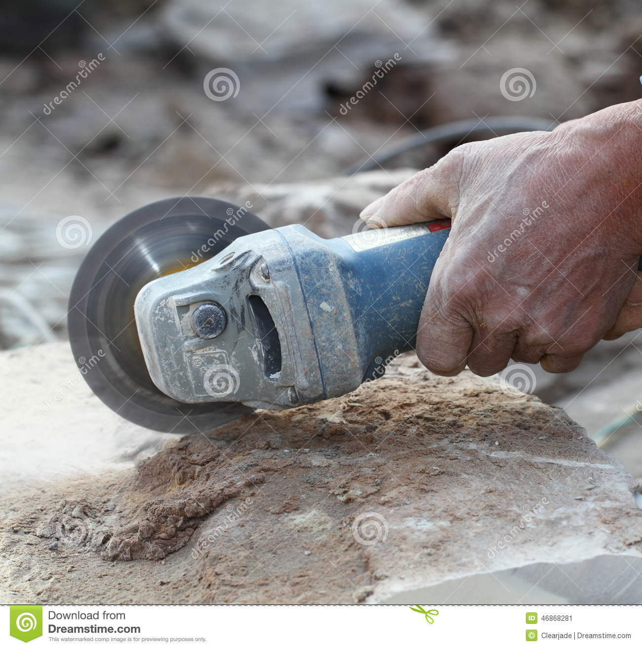 Grinder Worker Cuts A Stone The Electric Tool Stock Photo