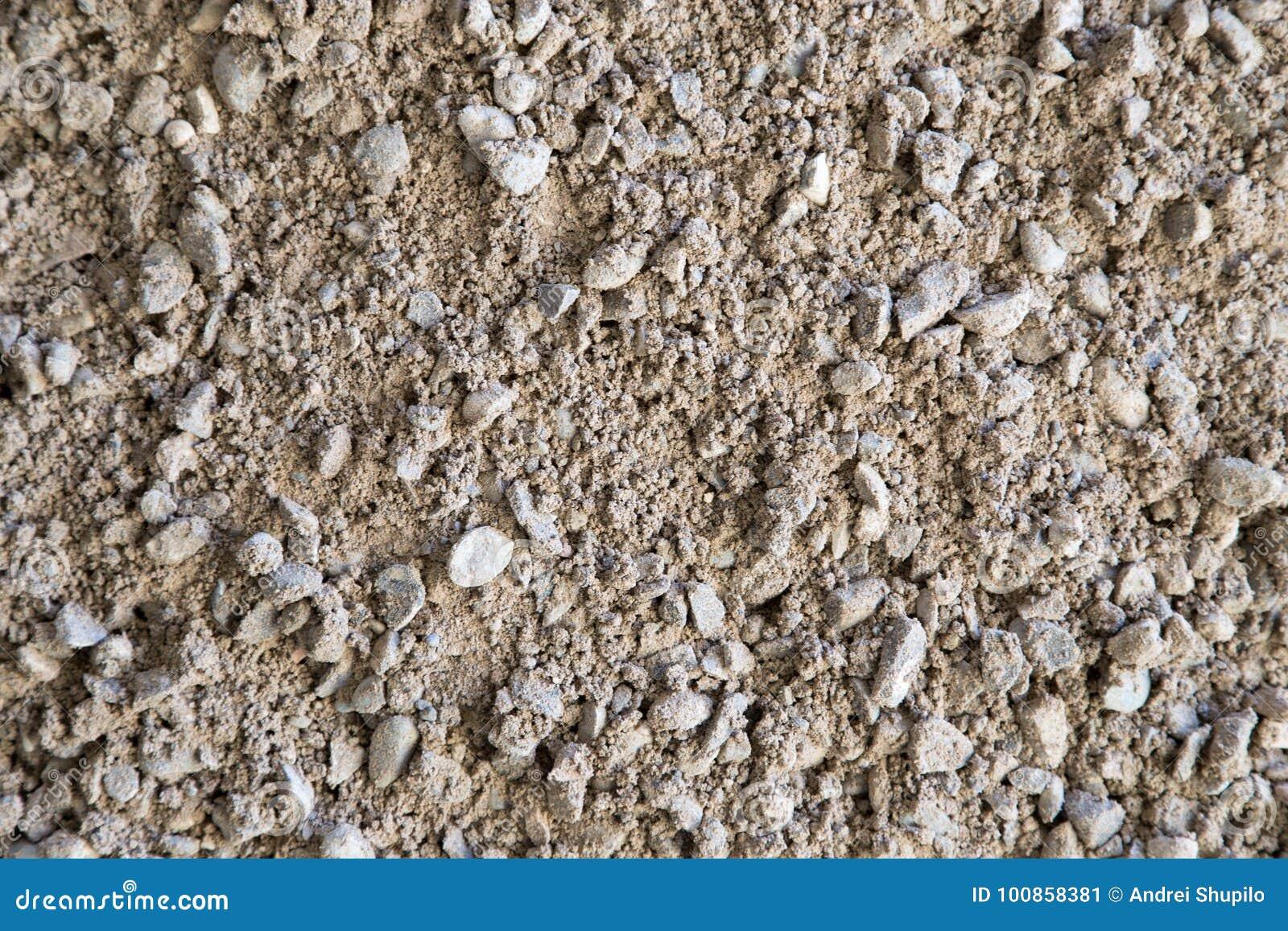 Grint, kiezelstenen en zandclose-up