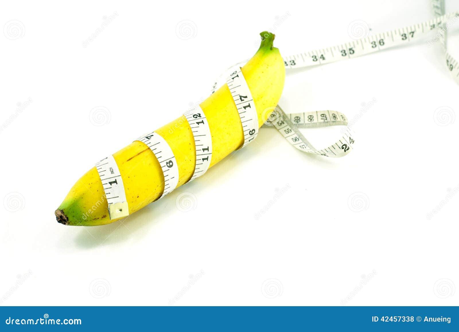 Große Banane und messendes Band
