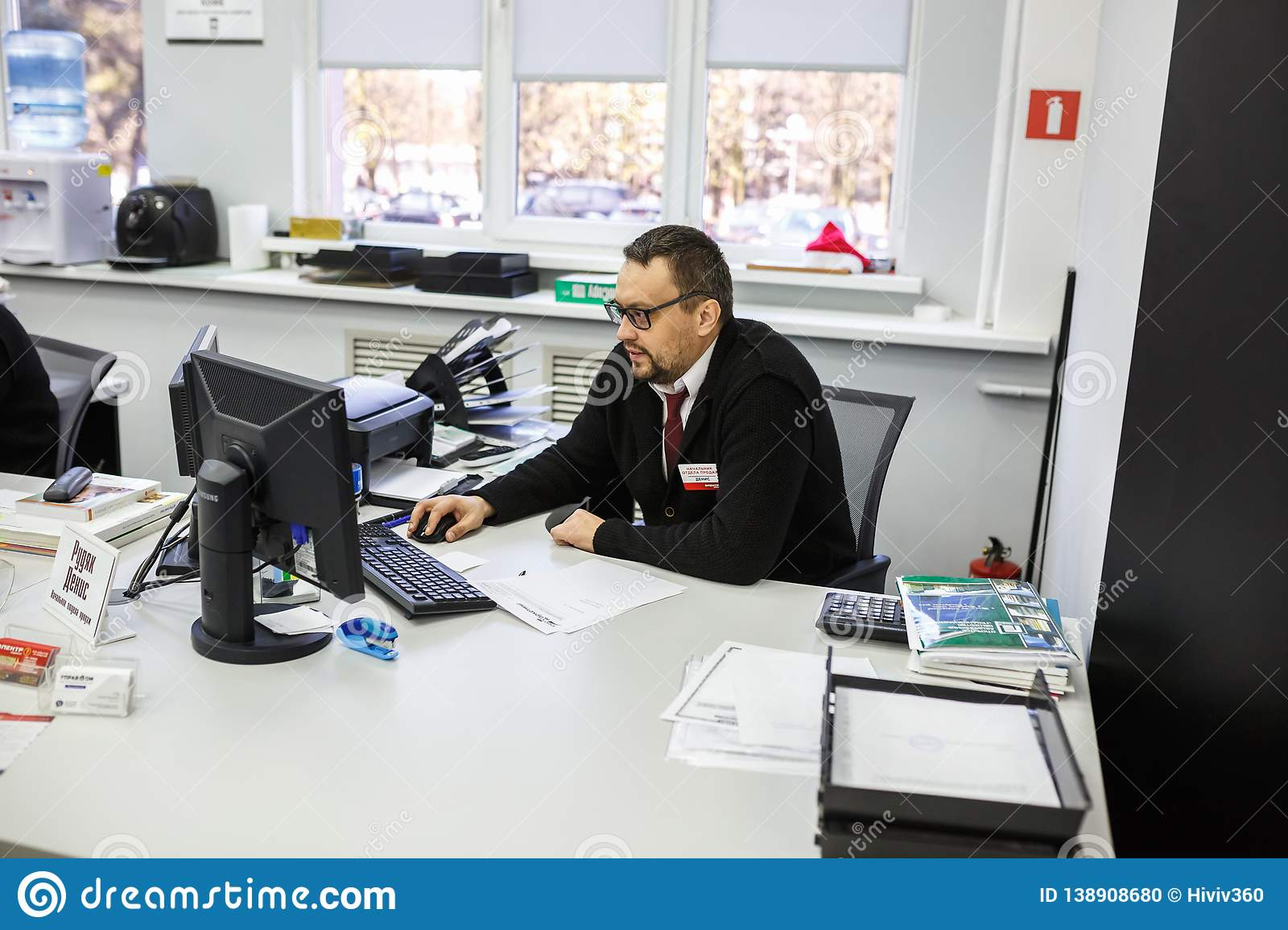 GRODNO, BELARUS - AUGUST 2017: employees to answer the call in the store at work at the computer in modern shop