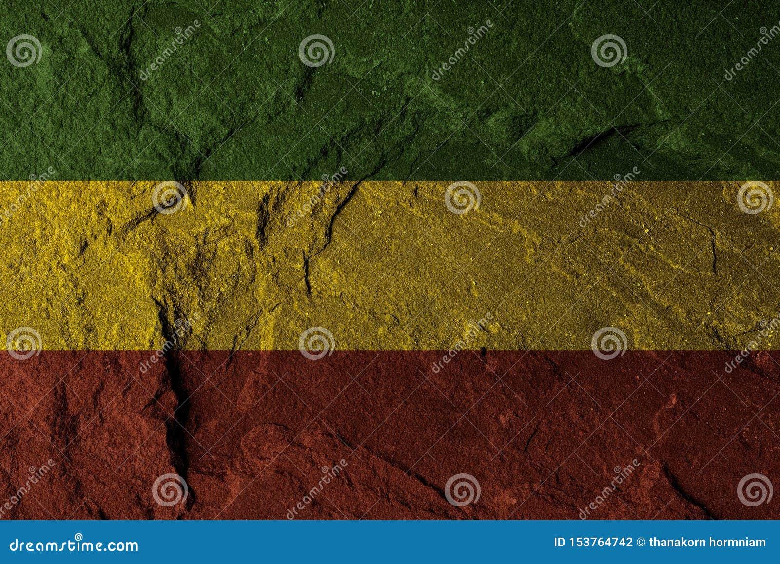 Groen geel rood op steenmuur, reggae achtergrondconcept