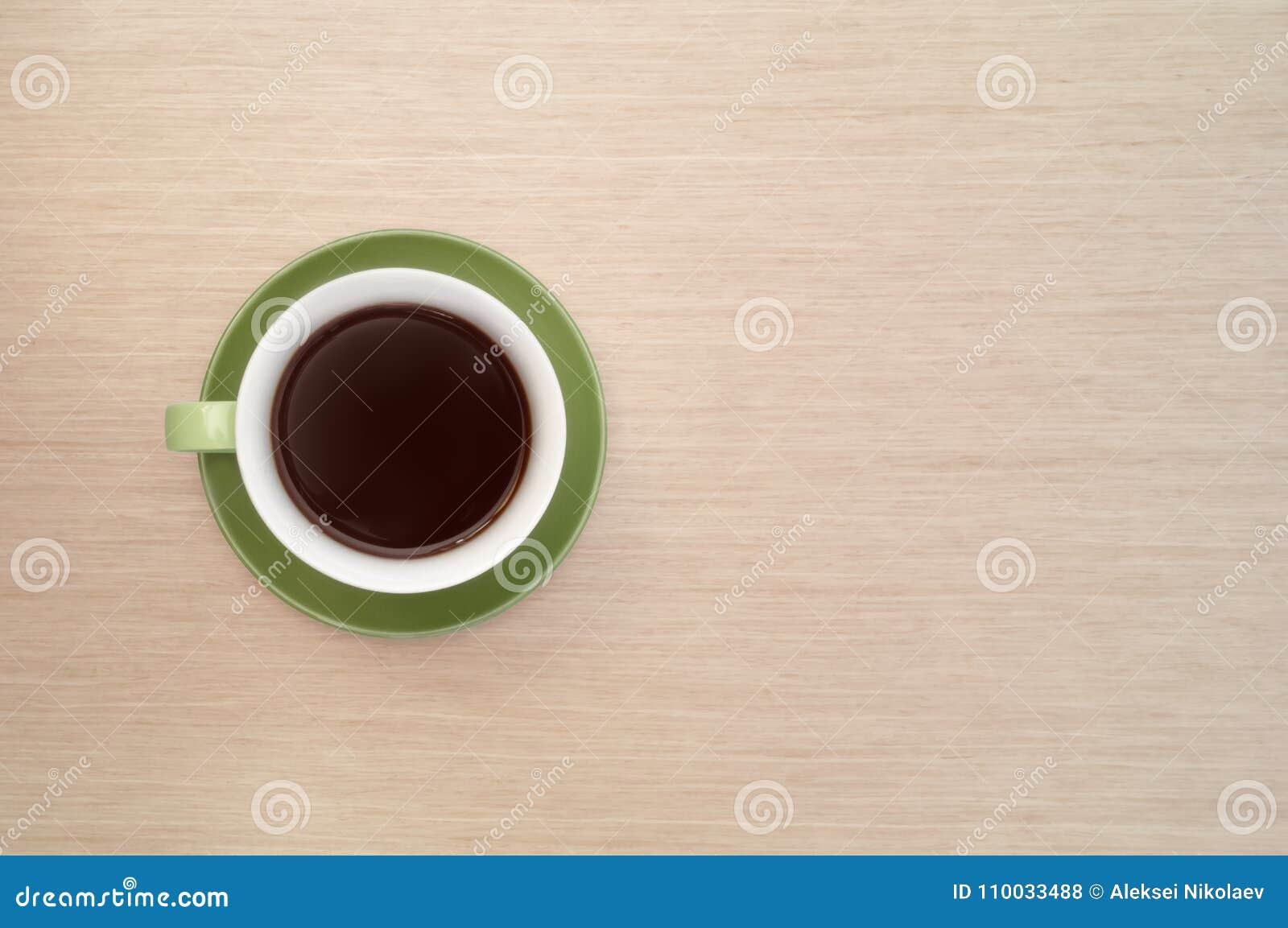 Groene kop van koffie