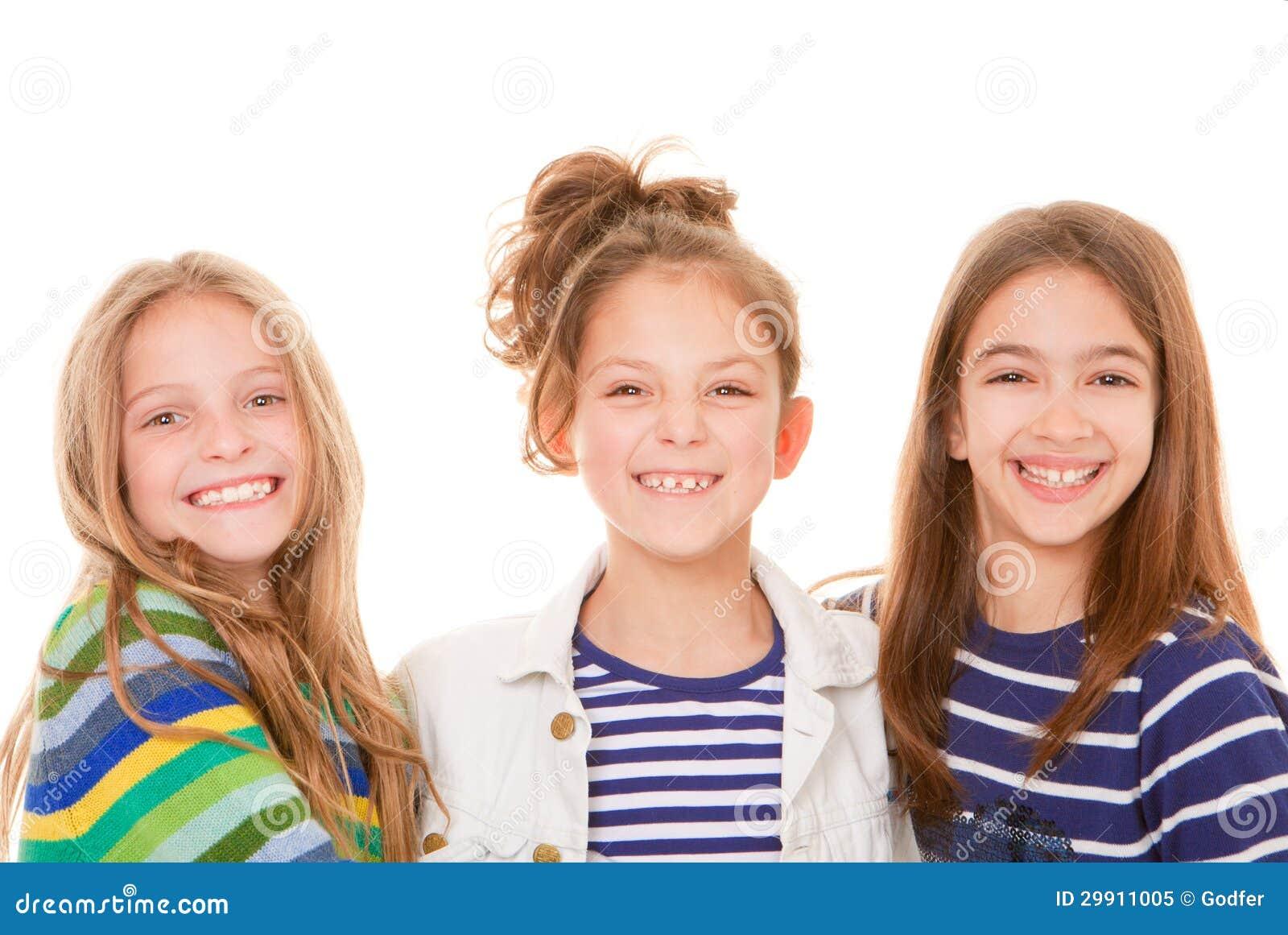 De gelukkige glimlachen van jonge geitjes