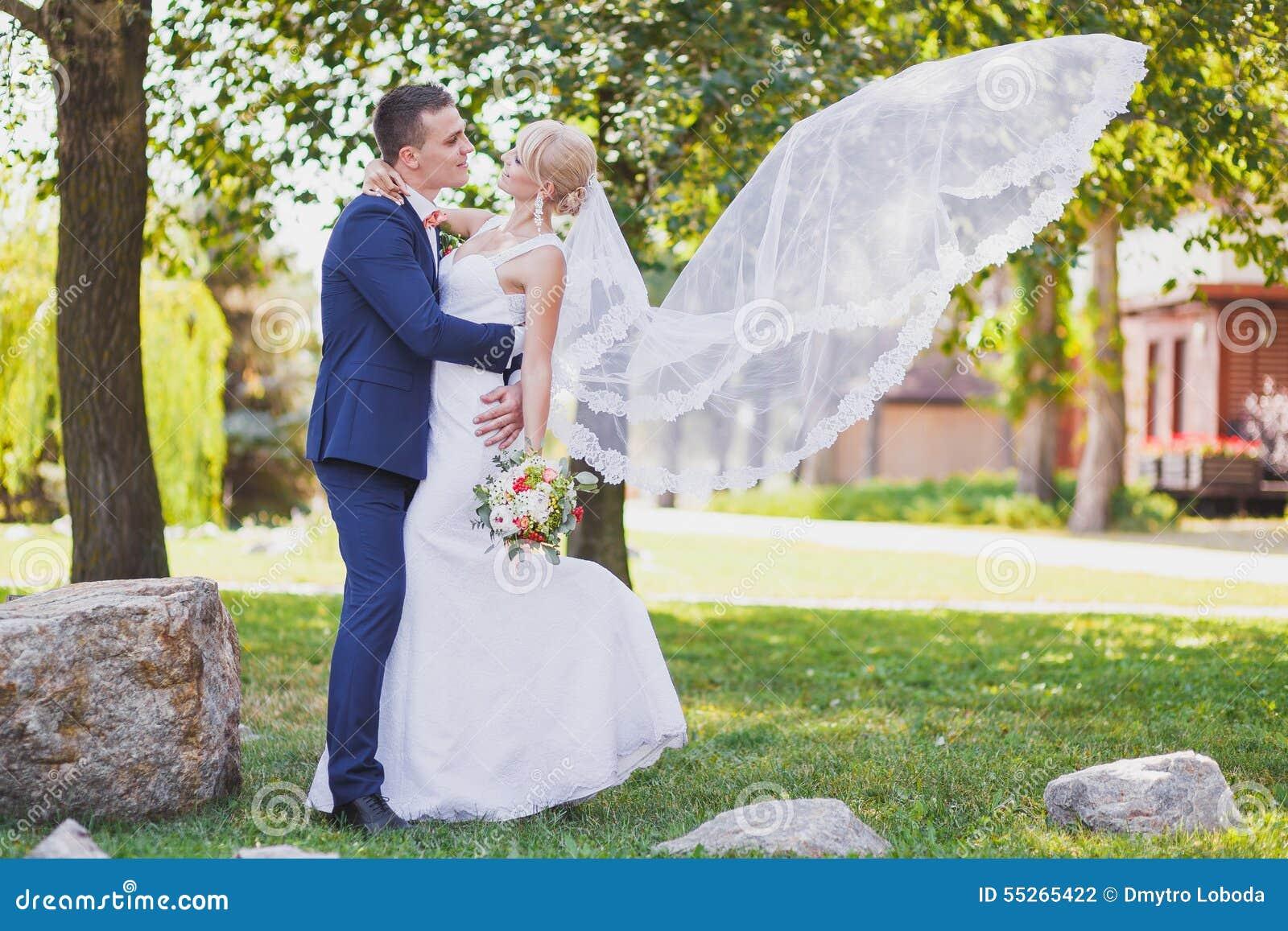 Groom Bride Bridal Veil Flying Stock Photo