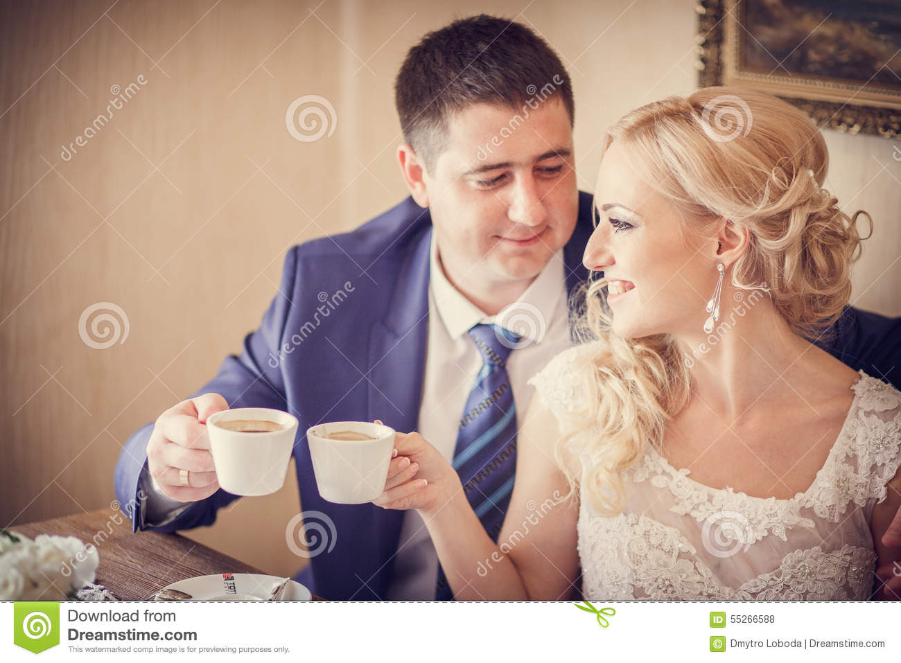 Groom, bride drink tea