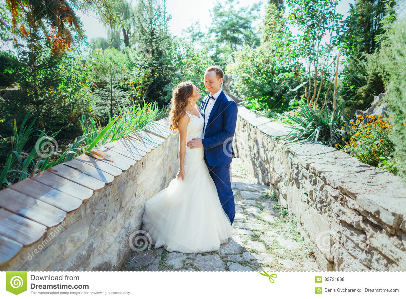 Groom And Bride Having Fun In Nature Stock Photo