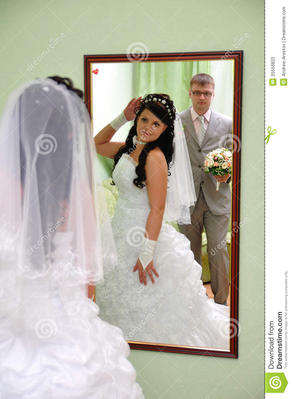 The Groom And The Bride Look In A Mirror Stock Photography ...