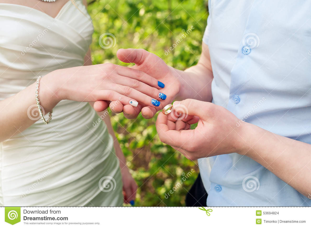 groom dresses bride golden wedding ring at the ceremony stock photo