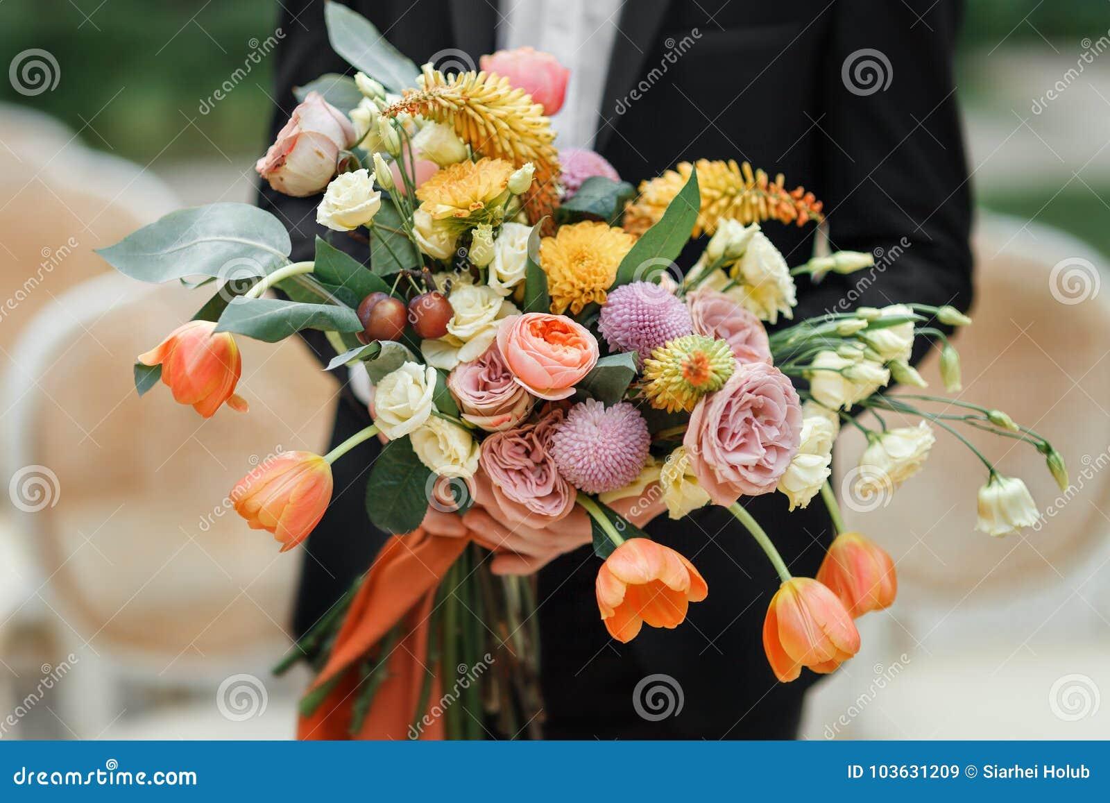 The groom hand bouquet of fresh flowers close up stock image image download the groom hand bouquet of fresh flowers close up stock image image of izmirmasajfo